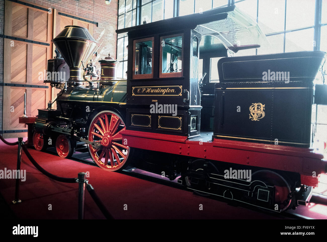 A very small 1863 steam locomotive named the C.P. Huntington for an early American railroad magnate is displayed - Stock Image