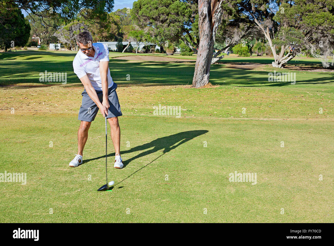 A golfer hitting the ball on a tee shot, teeing off, Perth, Australia - Stock Image