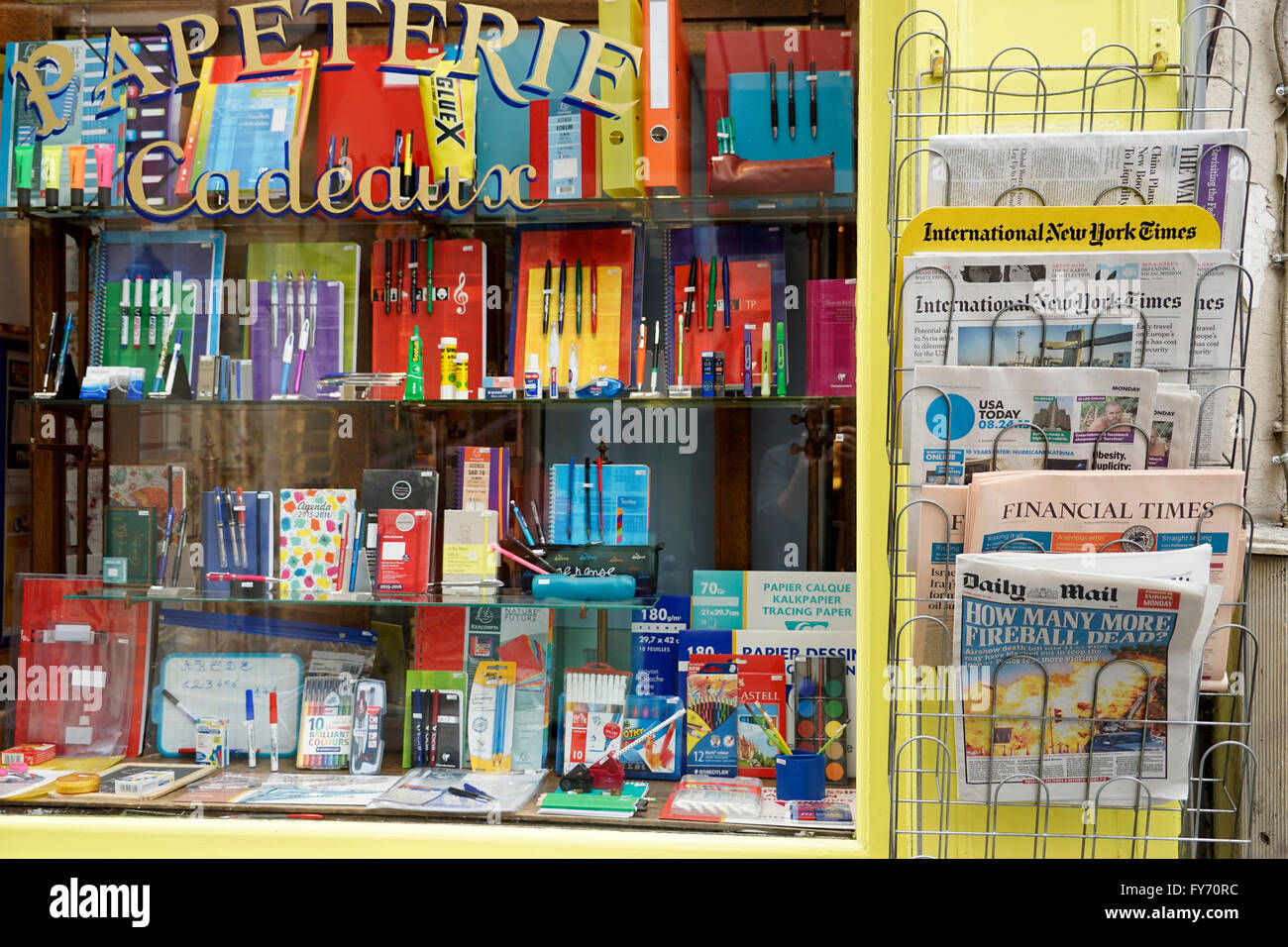 Ihram Kids For Sale Dubai: Window Of Stationery Store With Newspapers In Different