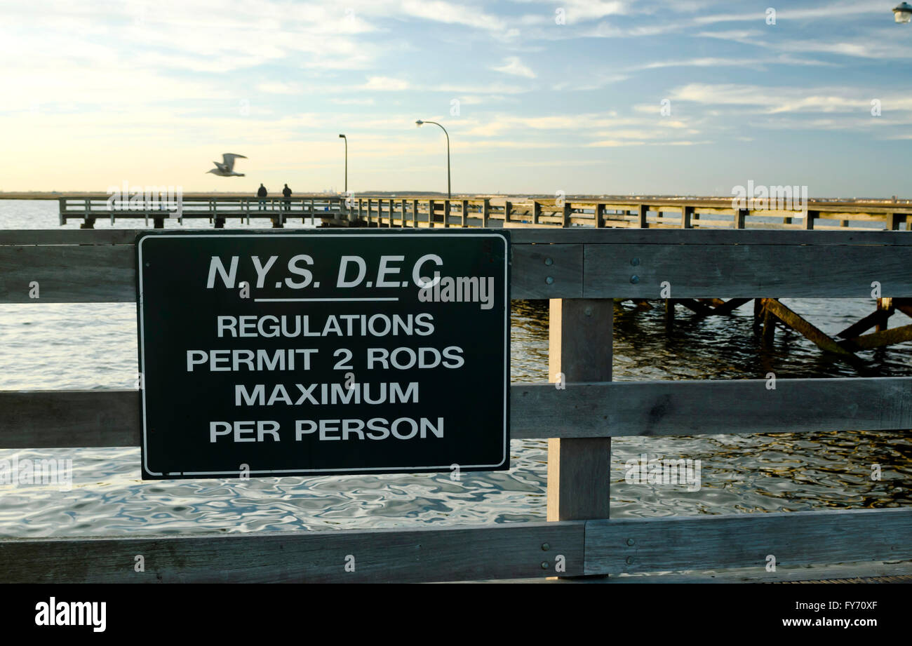 New York State Department of Environmental Conservation sign on fishing regulation on Jones Beach Pier - Stock Image