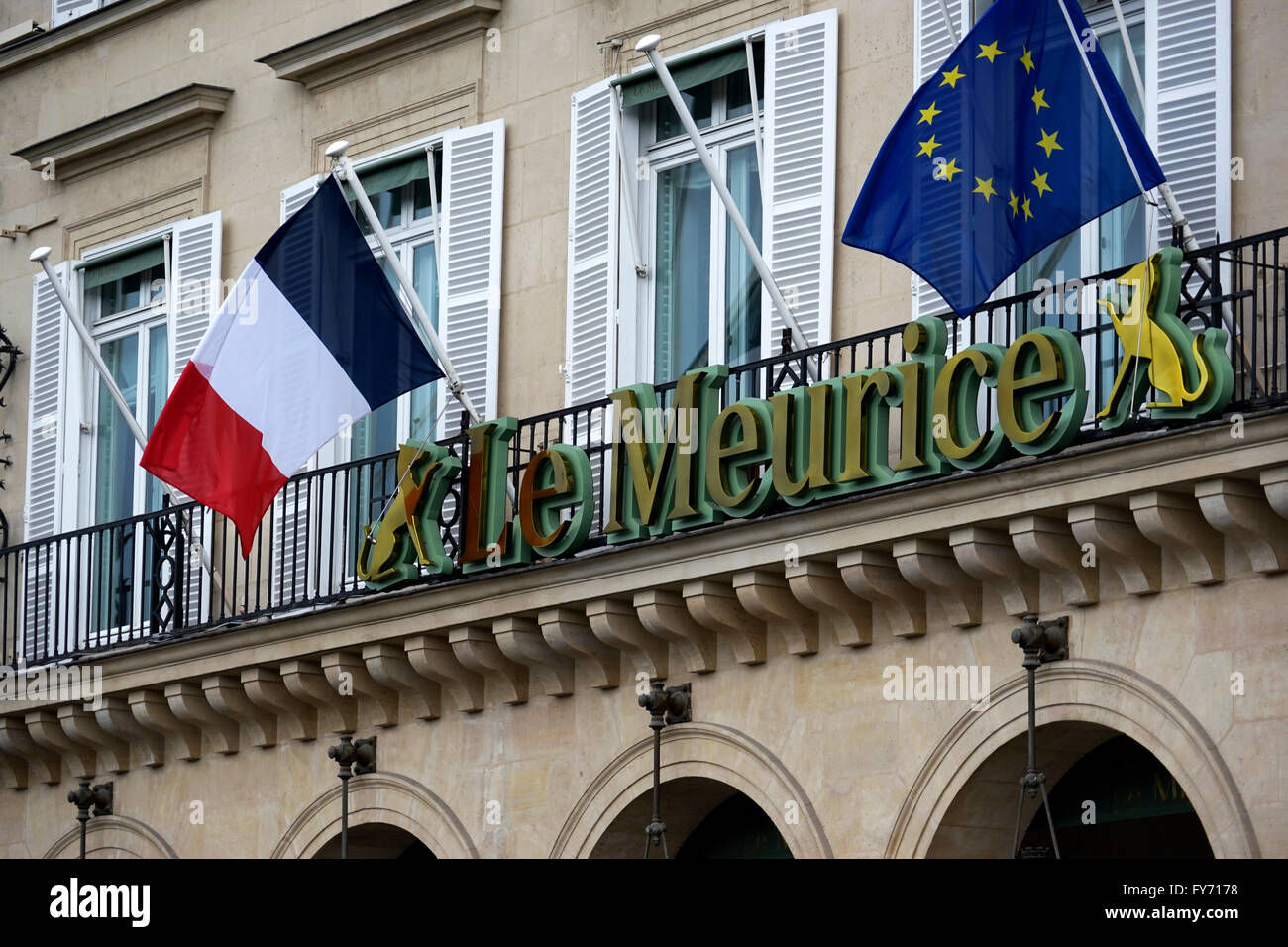 Hotel Le Meurice with French and European Union flags on Rue Rivoli,Paris France - Stock Image