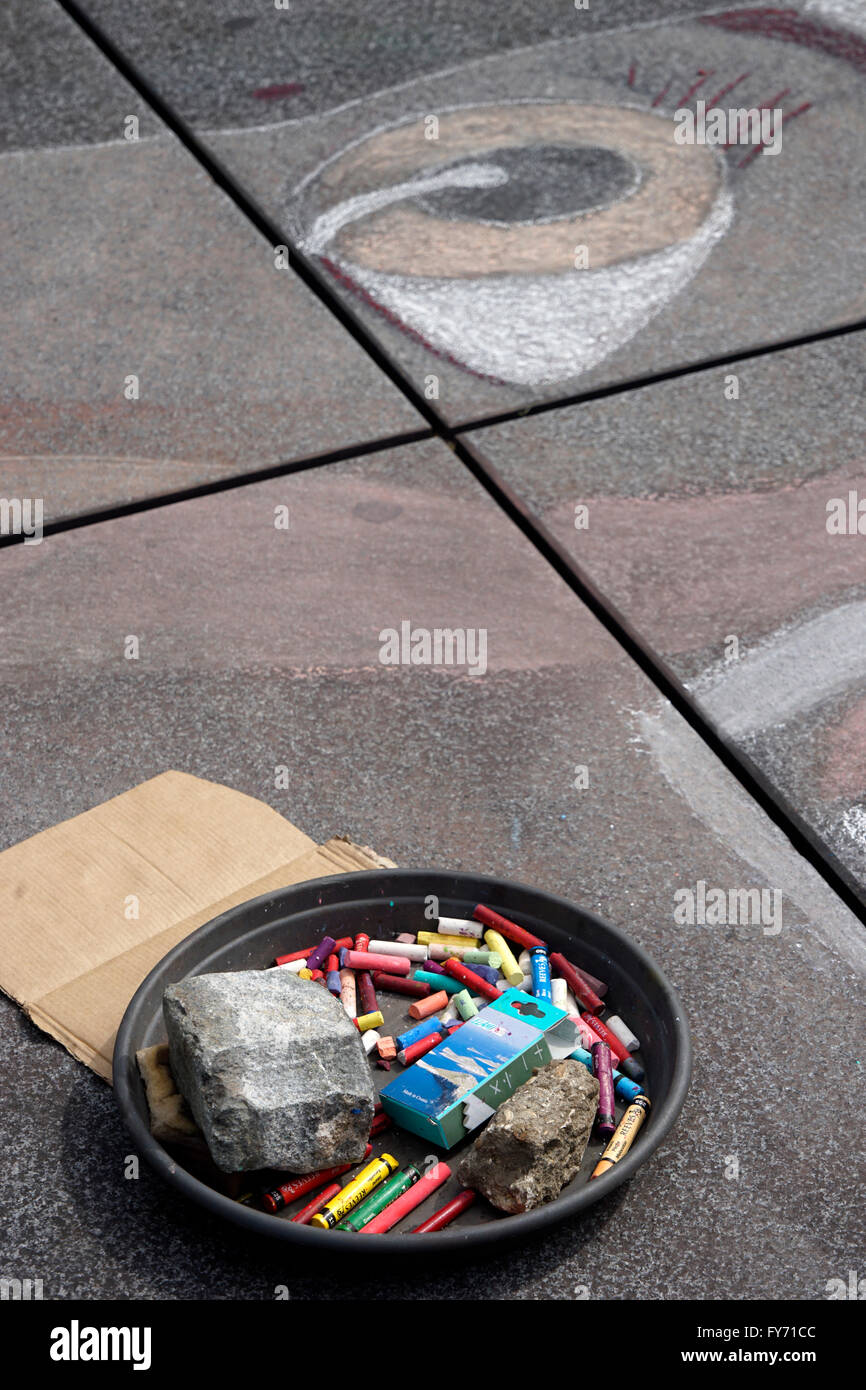 Drawing by a street artist on sidewalk near Centre Georges Pompidou with a plate of colorful chalks in foreground,Paris, - Stock Image