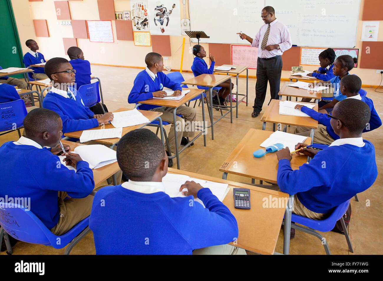 Teacher and students, Sentinel Kabitaka School students, Solwezi, Zambia - Stock Image