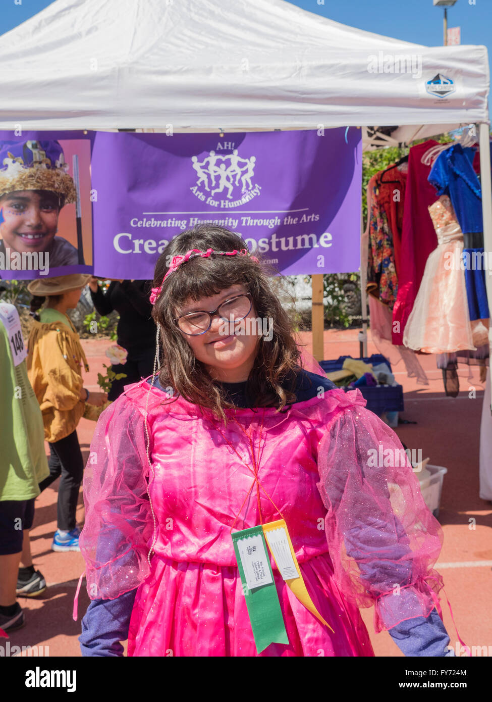 Playing dress up at a booth sponsored by the Arts for Humanity at the Southern California Special Olympics. - Stock Image