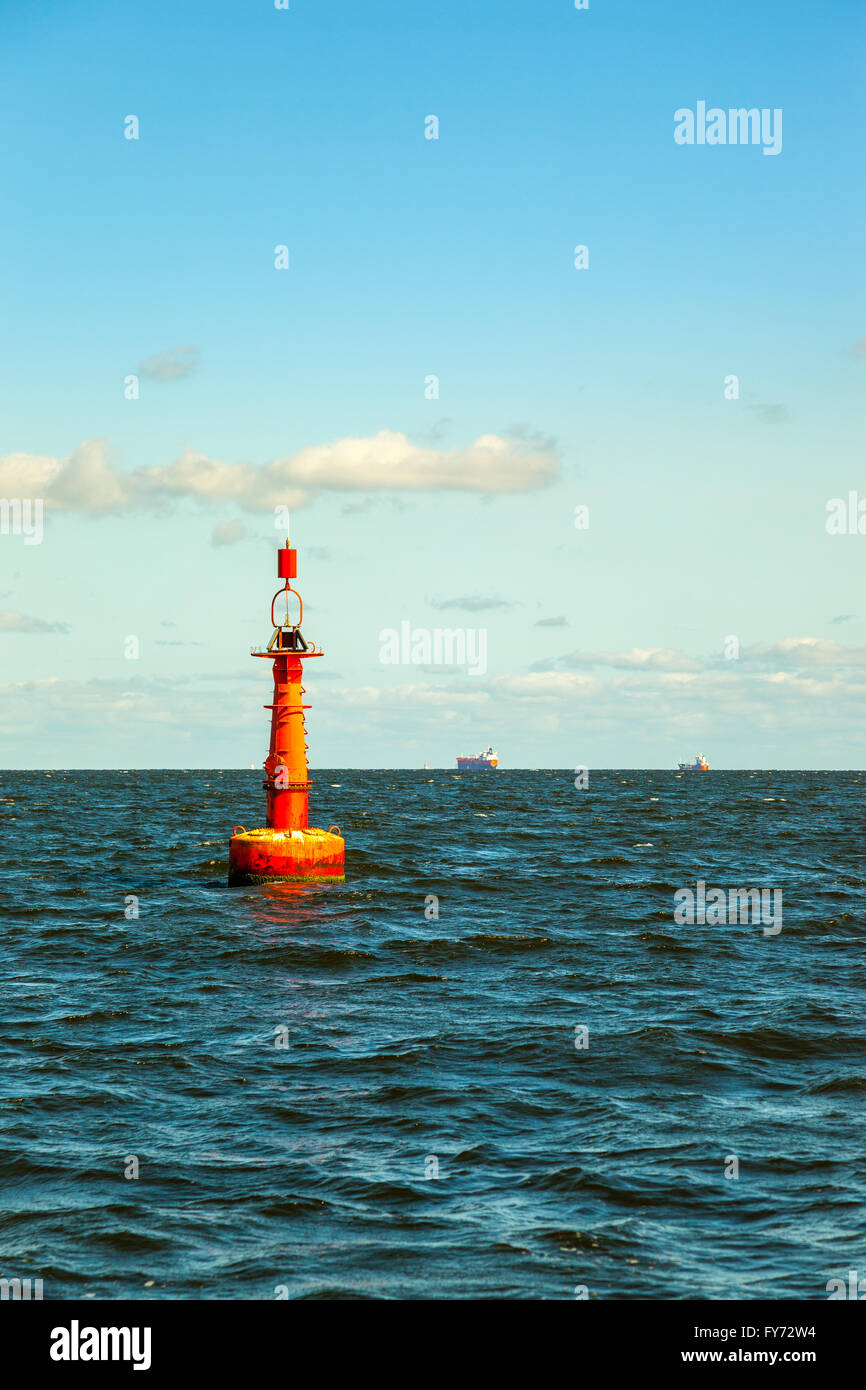 Navigation buoy at the edge of a fairway. - Stock Image