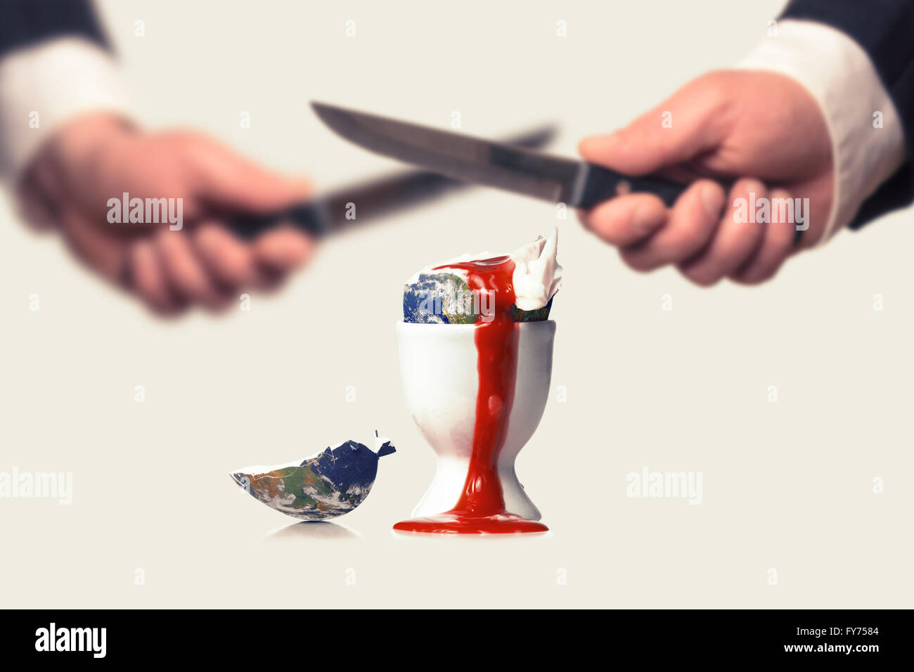 Businessmen destroy the earth with Knifes symbolized by a bleeding egg - Stock Image