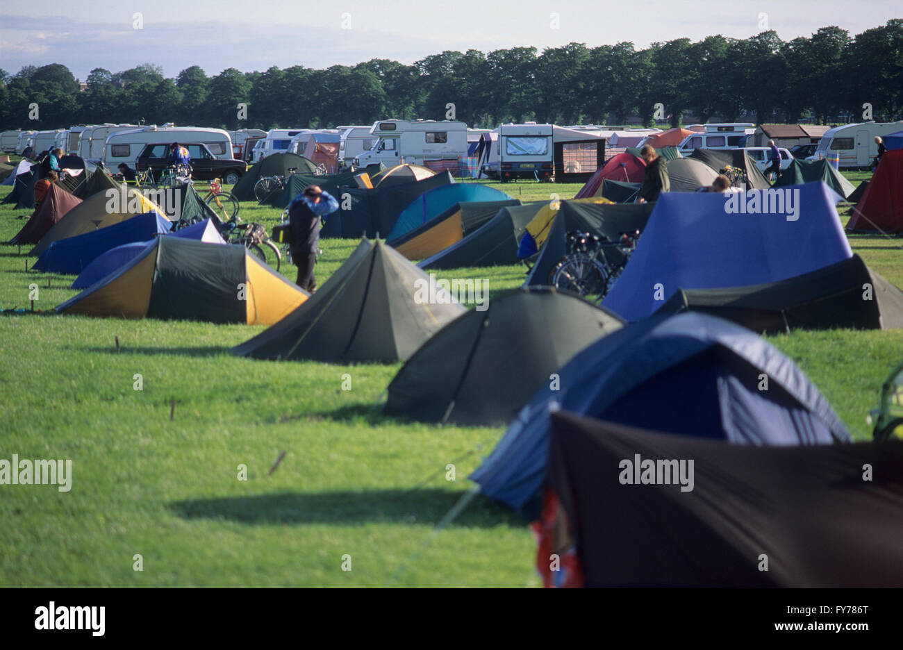 Tents and camper vans at a campsite. - Stock Image