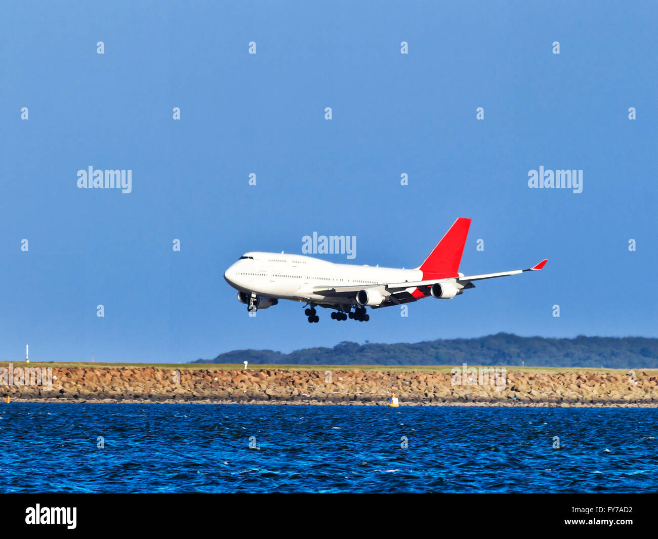 oversized double-deck airplane approaching airport runway during landing at Sydney international airport veiw from - Stock Image
