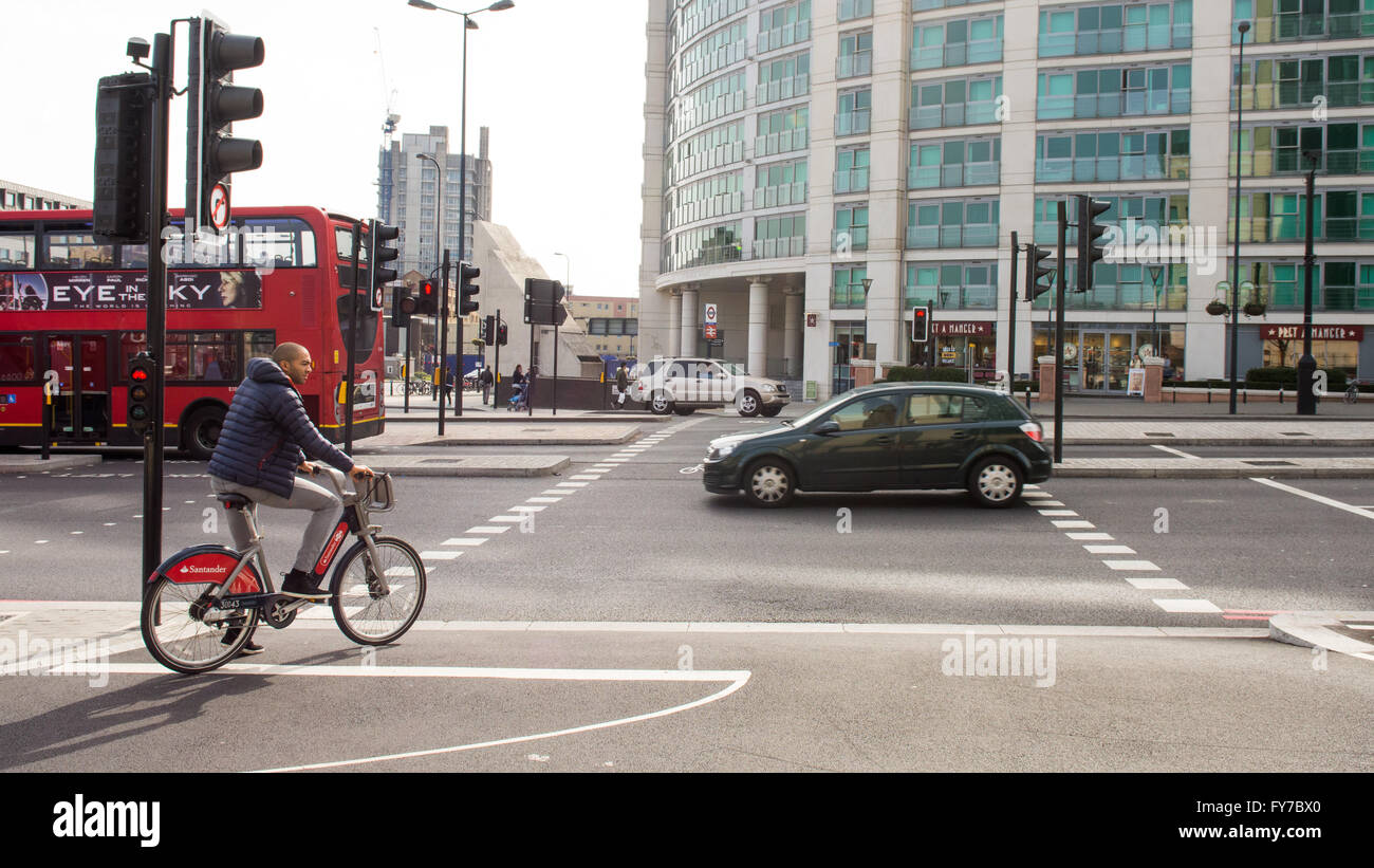 London, England - April 2, 2016: A cyclist using the newly opened Cycle Superhighway at Vauxhall in central London. - Stock Image