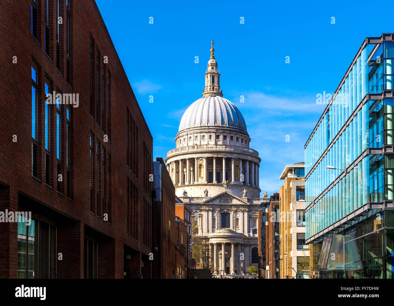 St Pauls Cathedral in London against a blue sky - Stock Image