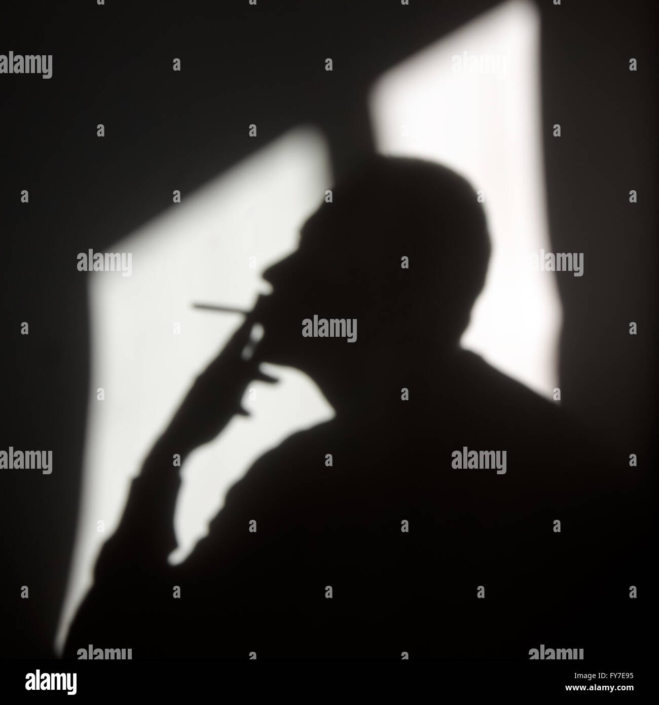 Blurry male smoker shadow indoor - Stock Image