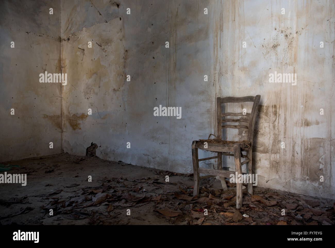 Interior of an abandoned spooky empty room with white ...