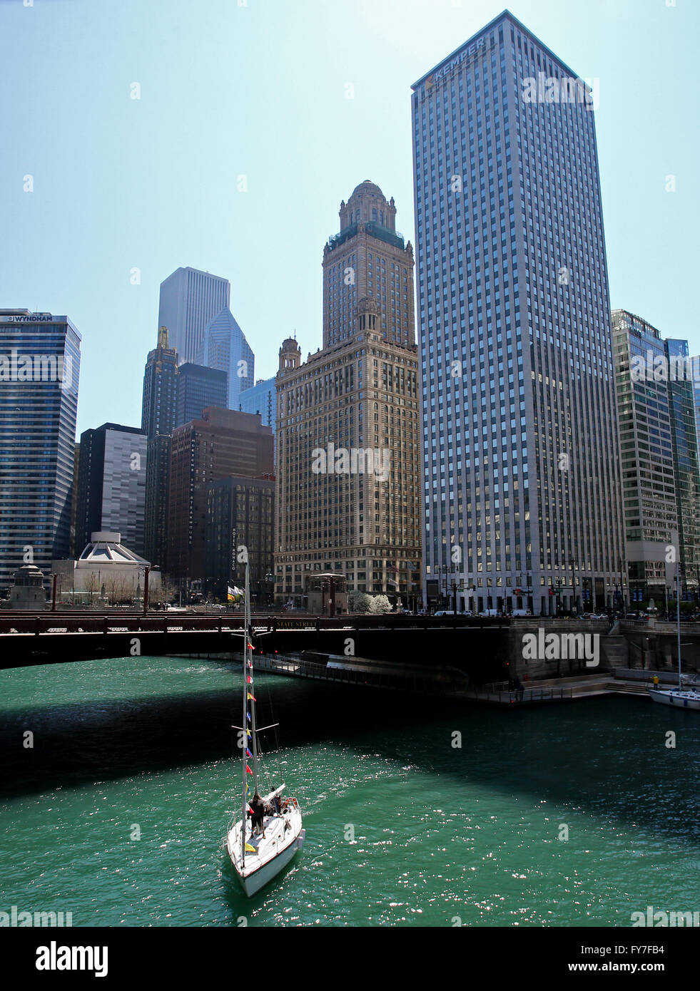 A Sailboat Makes Its Way Up The Chicago River In Chicago