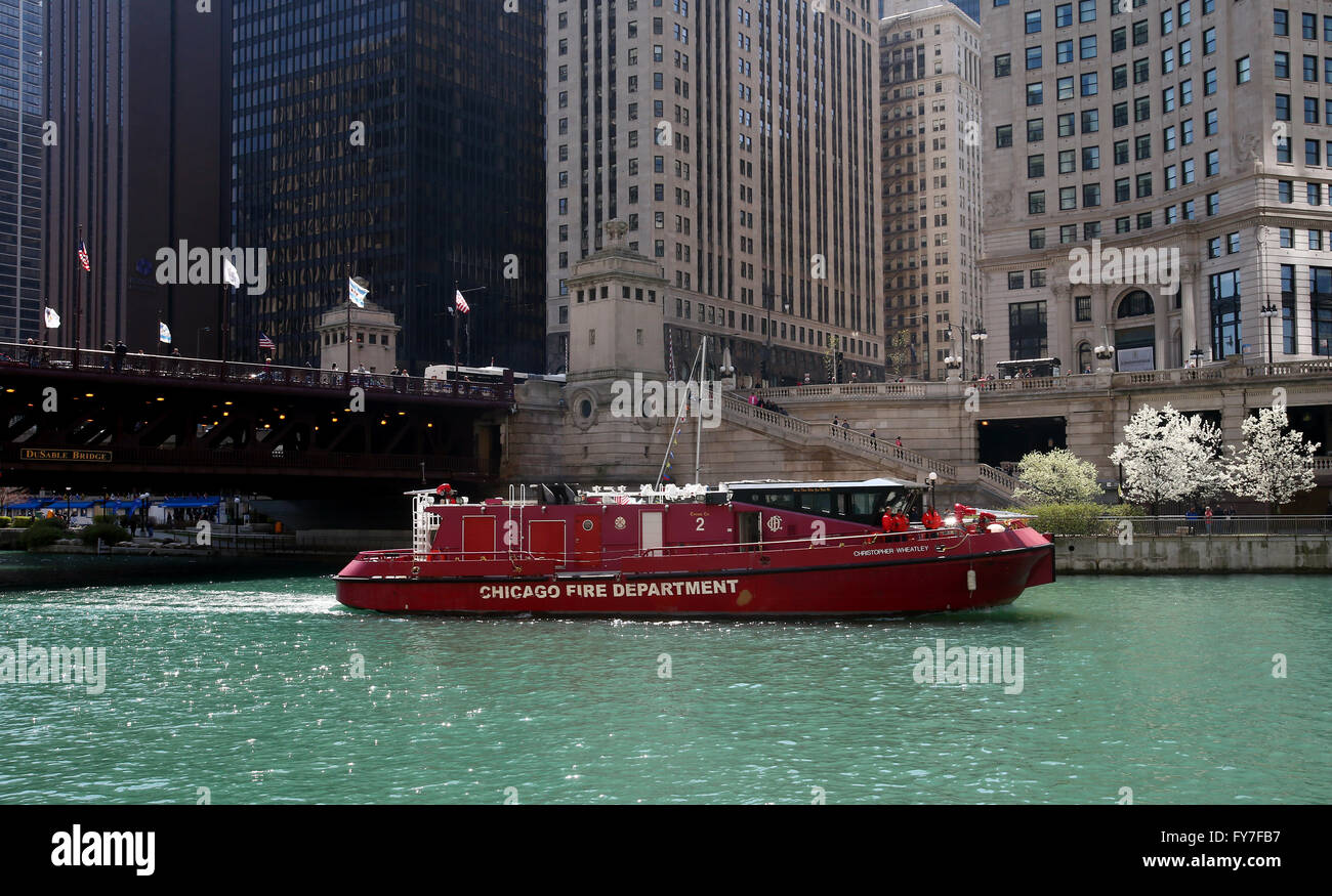 A Chicago Fire Department patrol boat makes its way along the Chicago River and Dusable Bridge in Chicago, Illinois, Stock Photo