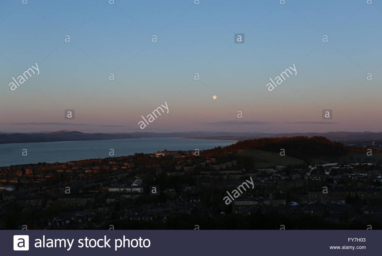 Full moon over Tay Estuary and Dundee at dawn Scotland  April 2016 - Stock Image