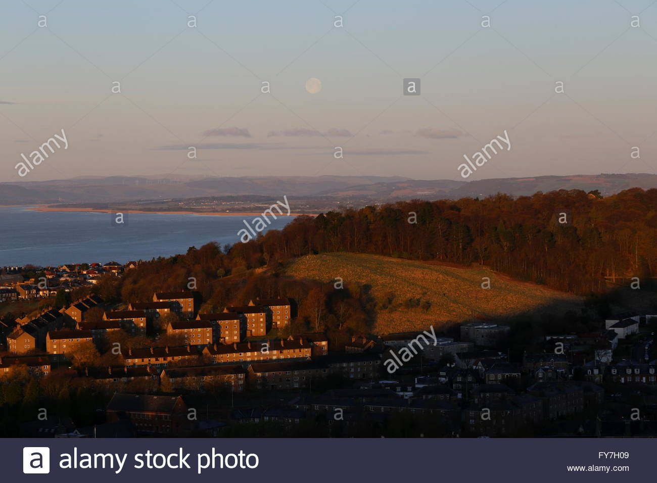 Full moon over western Dundee at dawn Scotland  April 2016 - Stock Image