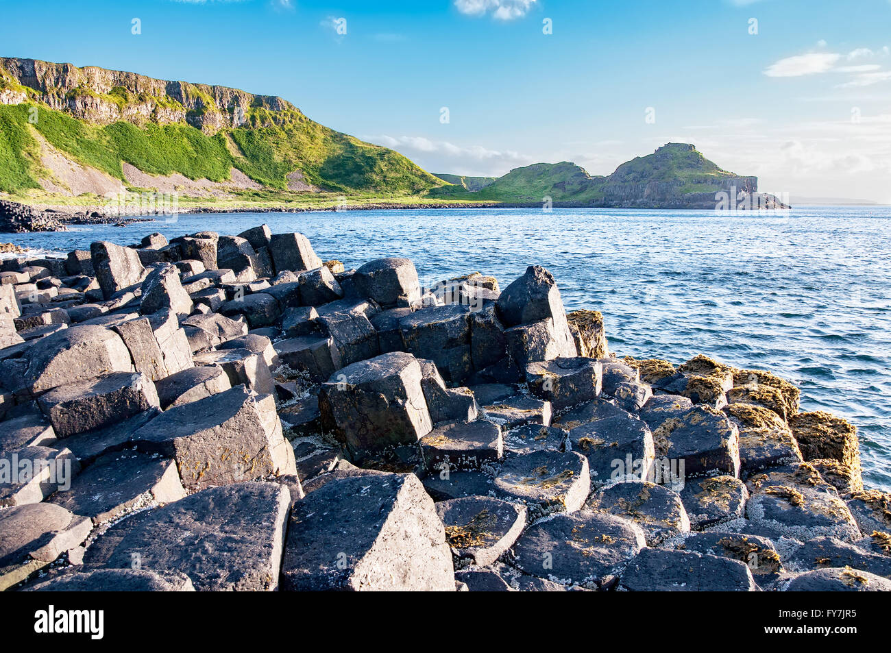 Giants Causeway, unique geological hexagonal formation of volcanic basalt rocks and cliffs in Antrim County, Northern - Stock Image