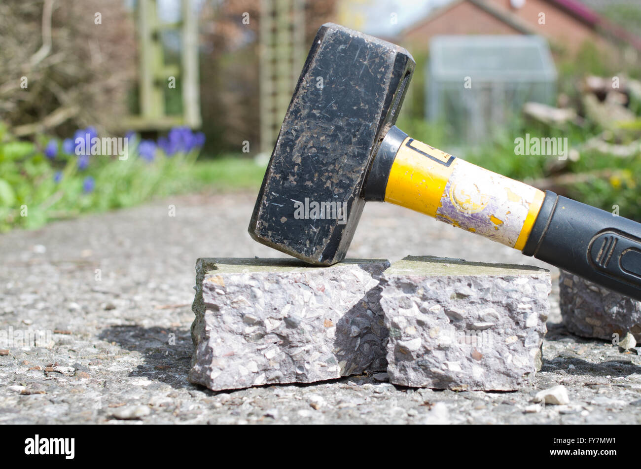 Hammer breaking up concrete - Stock Image