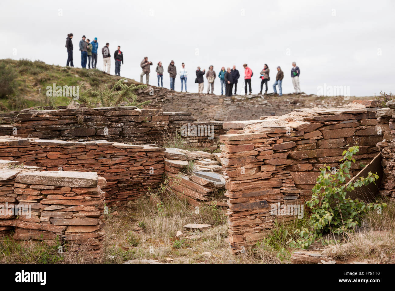 A group of people visiting the ruins of a prehistoric human settlement (Castro) in Galicia, north of Spain - Stock Image
