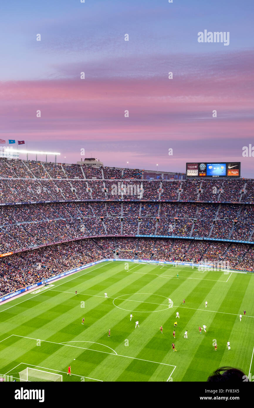 Camp nou football stadium in barcelona sunset is coloring clouds making even better the overall view as we watch fc barca playing for spanish la liga