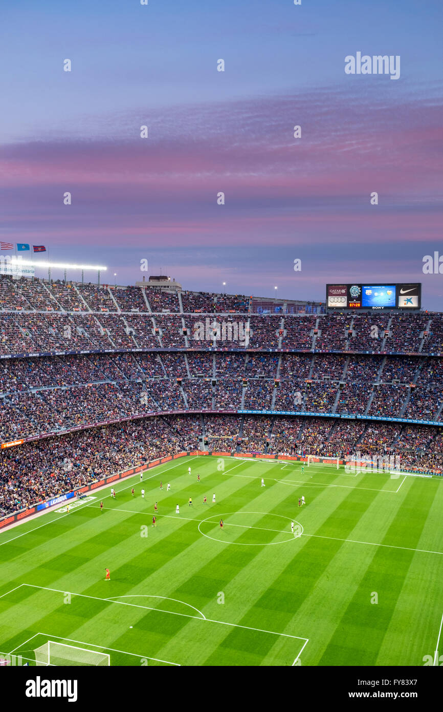 Camp Nou football stadium in Barcelona.Sunset is coloring clouds  making even better the overall view as we watch Stock Photo