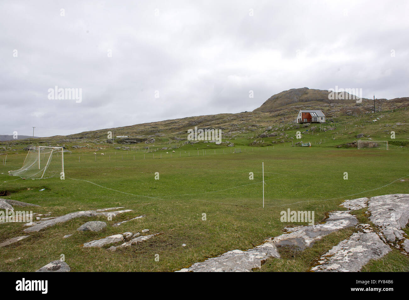 A remote football field on the island of Eriskay in the Outer Hebrides, Western isles of Scotland. - Stock Image