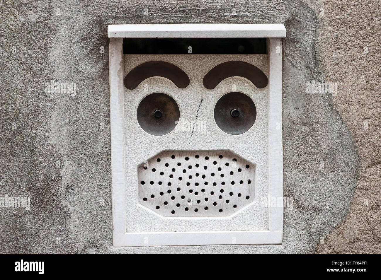 Abstract, looks like face intercom in Venice. - Stock Image