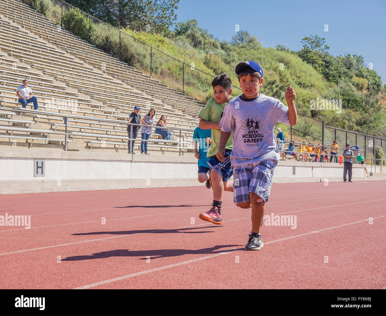 Disabled boys race at the Southern California Special Olympics held at La Playa Stadium at Santa Barbara City College. - Stock Image