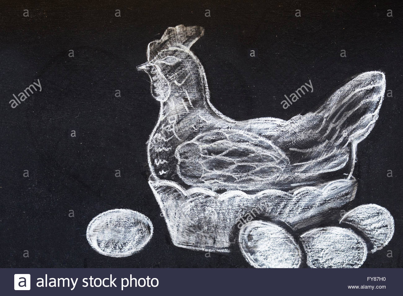 Blackboard outside a Pub, Chalk drawing of a hen with eggs - Stock Image