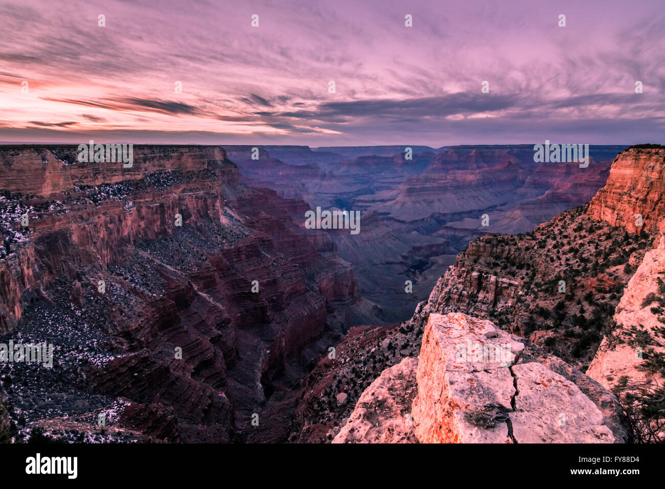 The rocks of the Grand Canyon reflecting the pink of the Arizona sunset Stock Photo