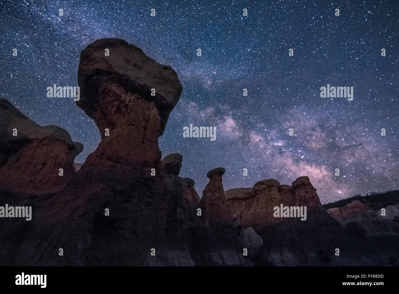 Rock spires silhouetted against the Milky Way on a dark night in eastern Colorado - Stock Image