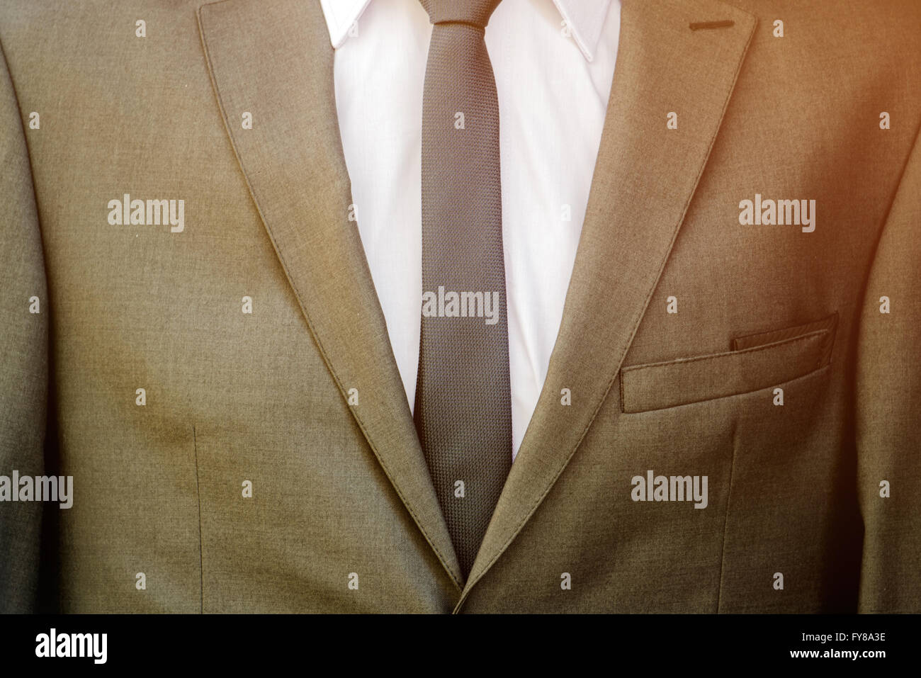 Modern business suit detail with white shirt and necktie, unrecognizable businessman. Stock Photo