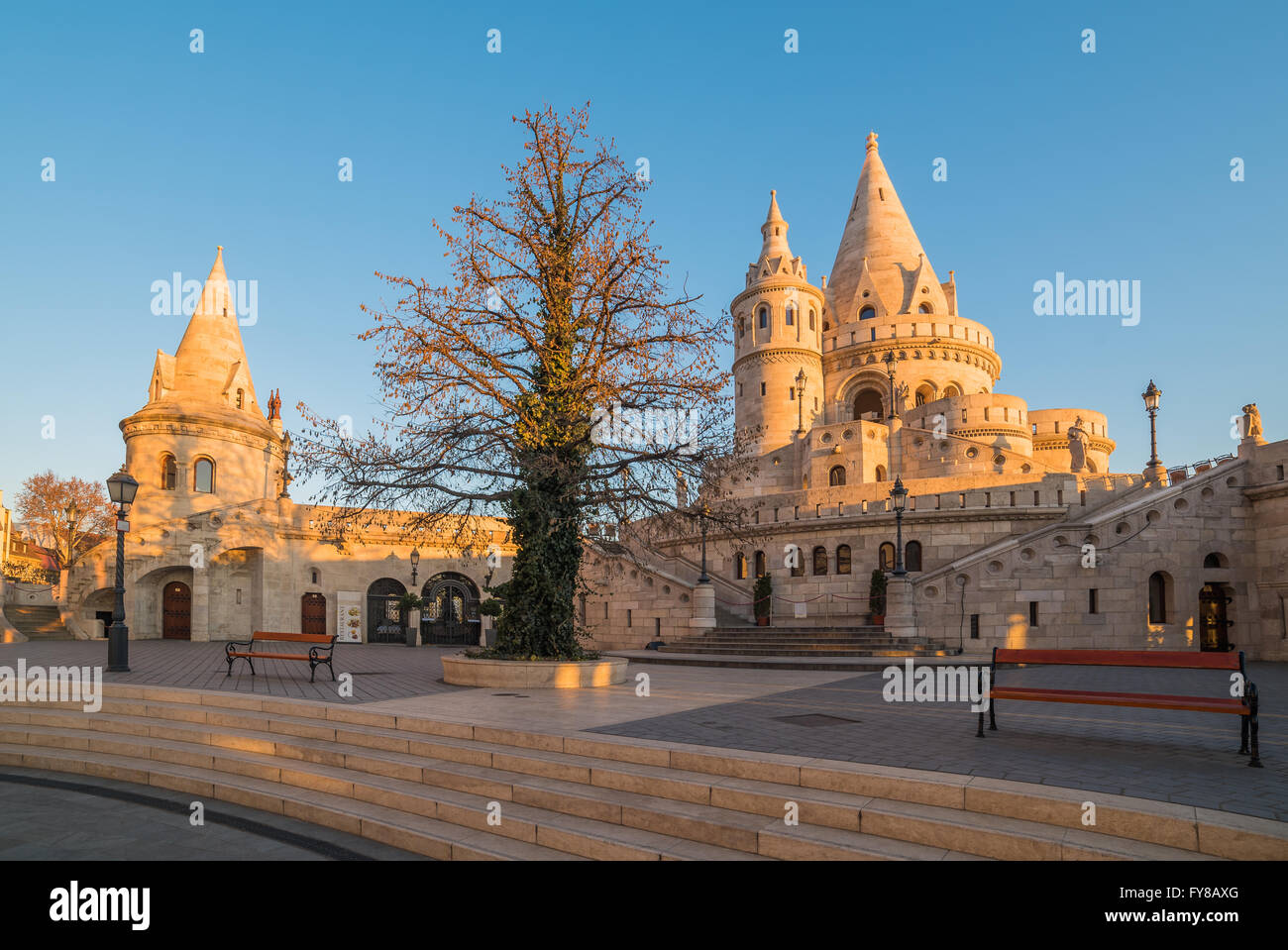 Fisherman's Bastion in Budapest, Hungary at Sunrise with Clear Blue Sky - Stock Image