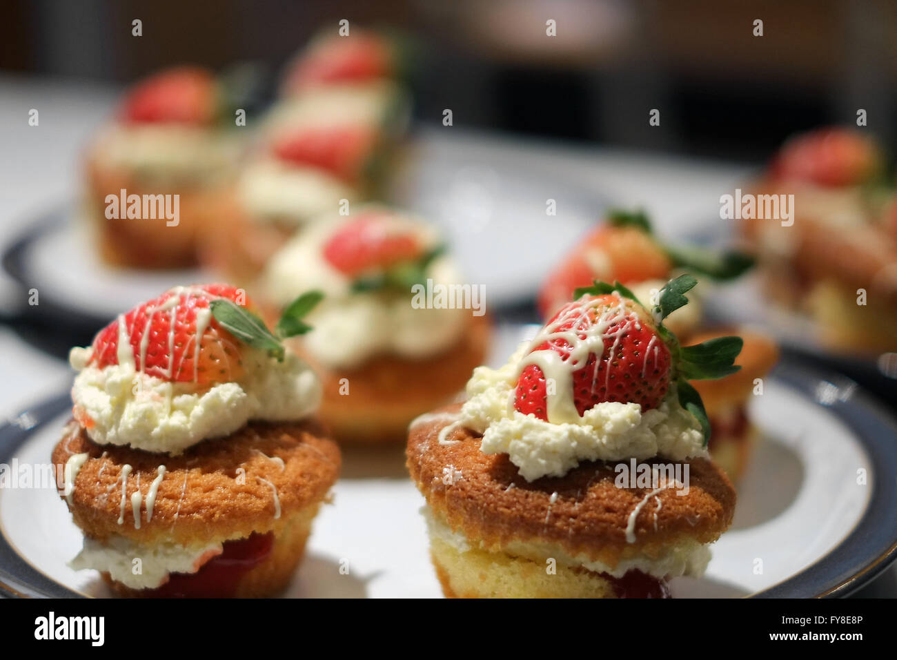 Homemade strawberry and cream cakes as part of a student baking project. Stock Photo