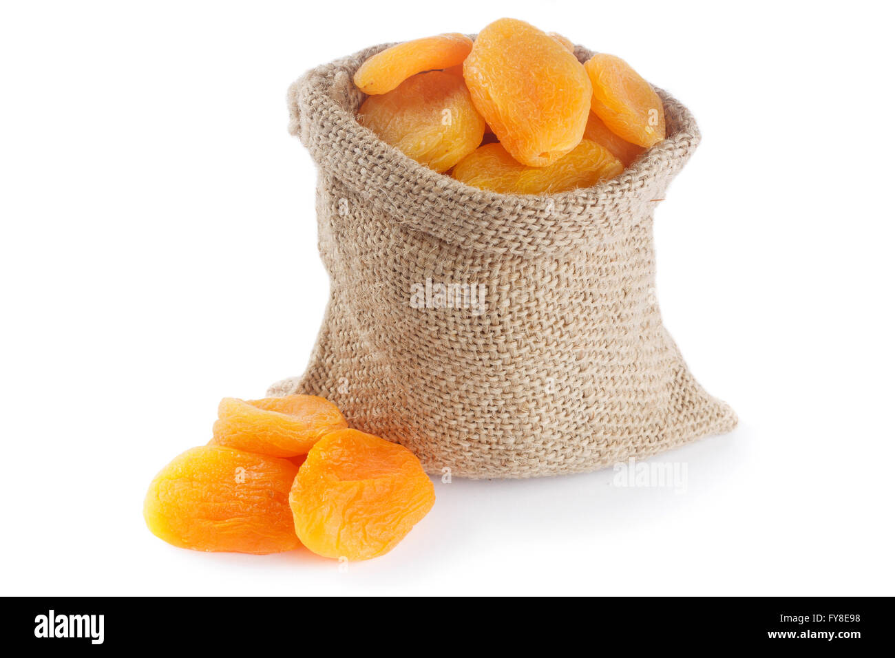 Dried apricots in small burlap bag - Stock Image