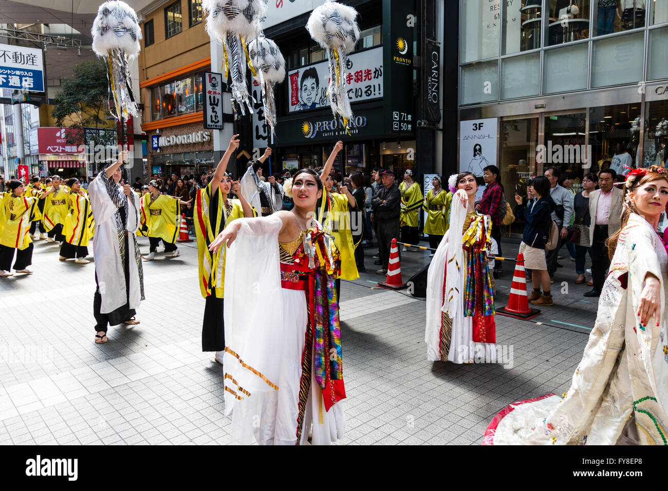 Japanese female dance troupe, walking in possession as part of Yosakoi dancing routine, dressed as princess and - Stock Image