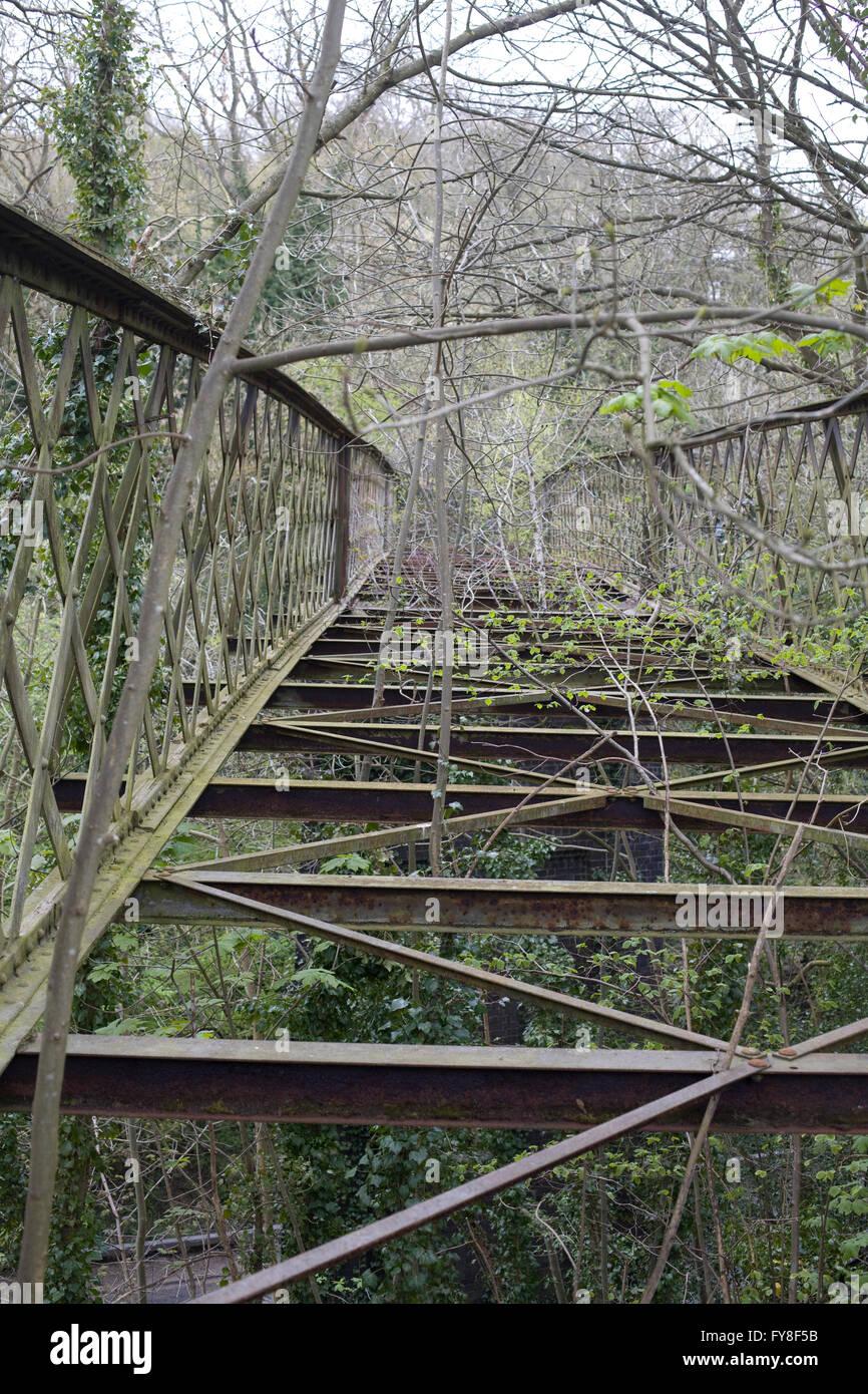 Old collapsed Iron bridge - Stock Image