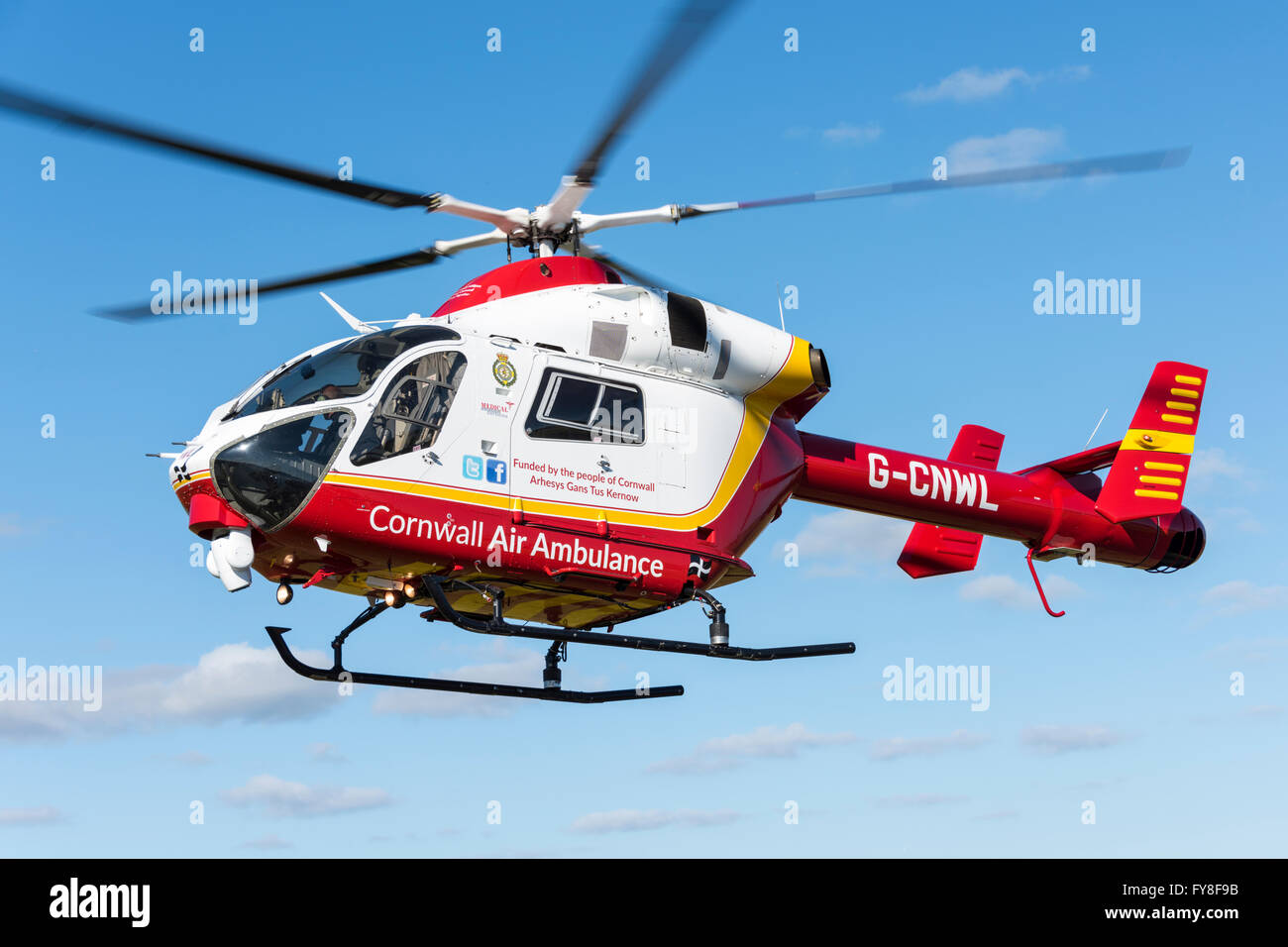 McDonnell Douglas MD902 Explorer helicopter (air ambulance) hovering - Stock Image