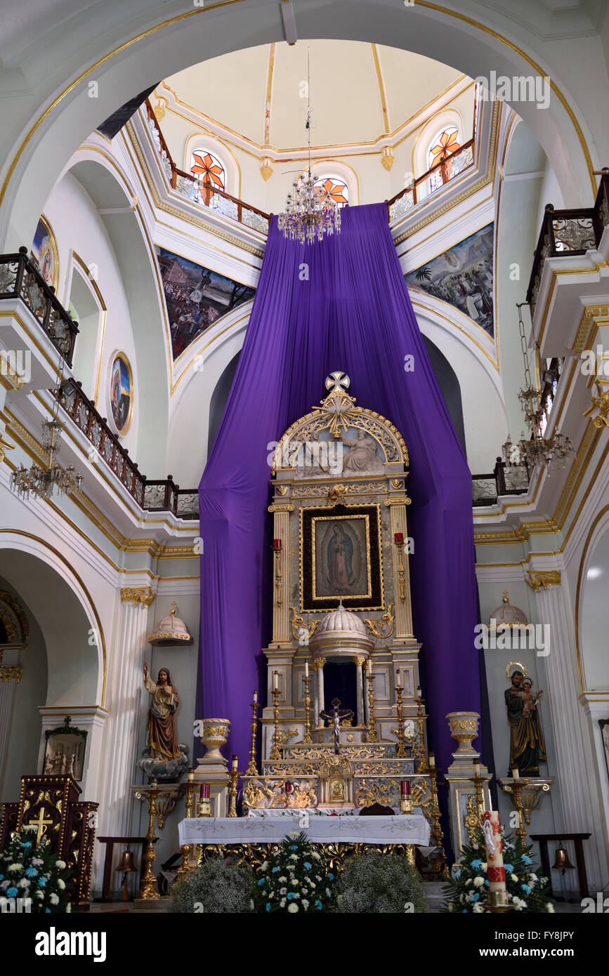 Interior sanctuary with altar and tabernacle Our Lady of Guadalupe Catholic church Puerto Vallarta Mexico - Stock Image