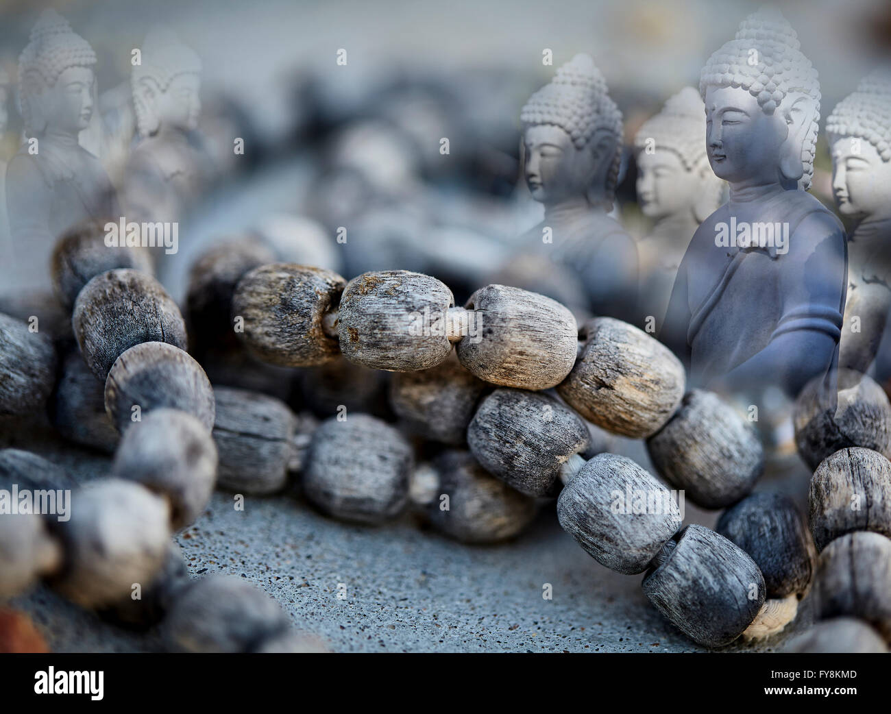 Weathered Prayer Beads with Meditating Buddha Spirit Guides concept photograph Stock Photo