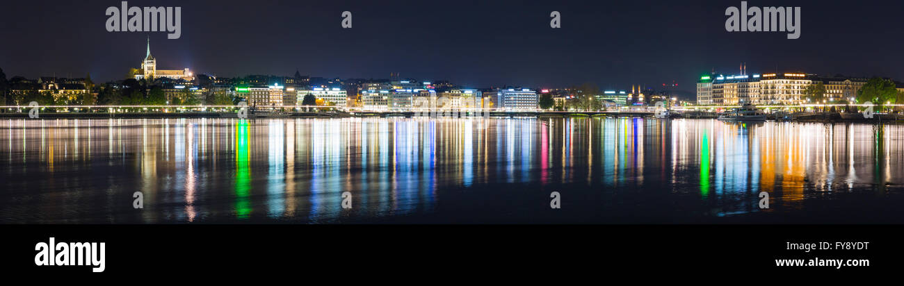 Panoramic view of lake Geneva and Geneva city skyline at night. - Stock Image