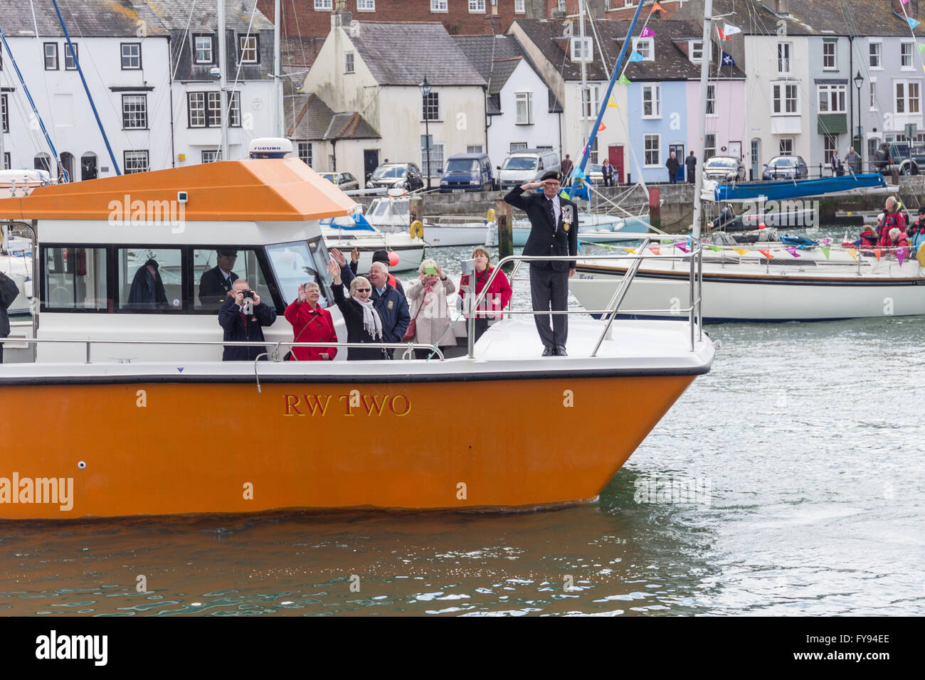 Weymouth, England. 23 April 2016. Queen's 90th Birthday Floating Tribute. RW Two, people waving, man saluting. - Stock Image