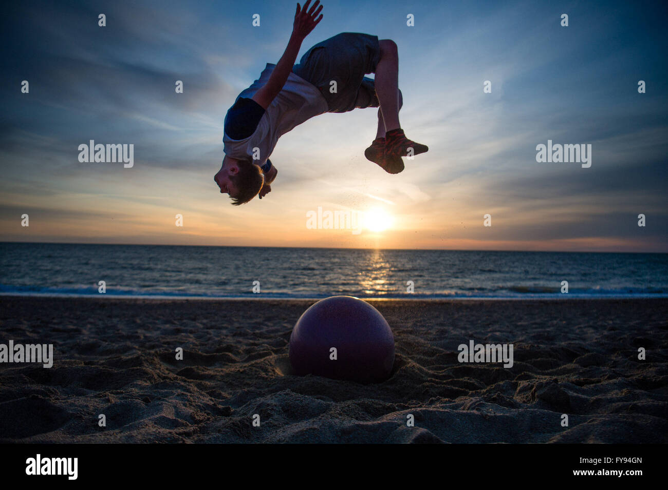 Aberystwyth Wales UK, Saturday 23 April 2016 UK weather: As the sun sets over Cardigan Bay in Aberystwyth at the - Stock Image