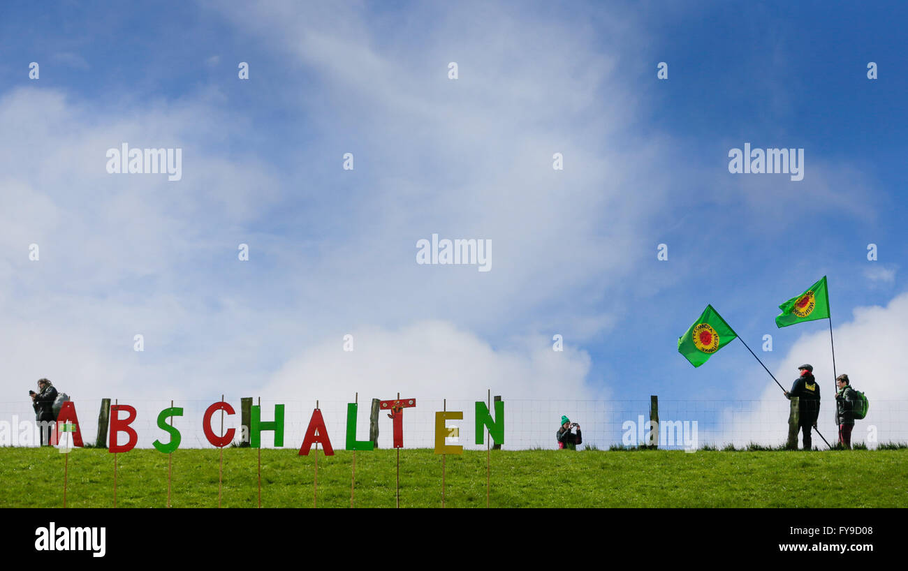 Letters that reads 'Abschalten' (lit. Shut it down) pictured next to flags featuring the anti-nuclear power - Stock Image