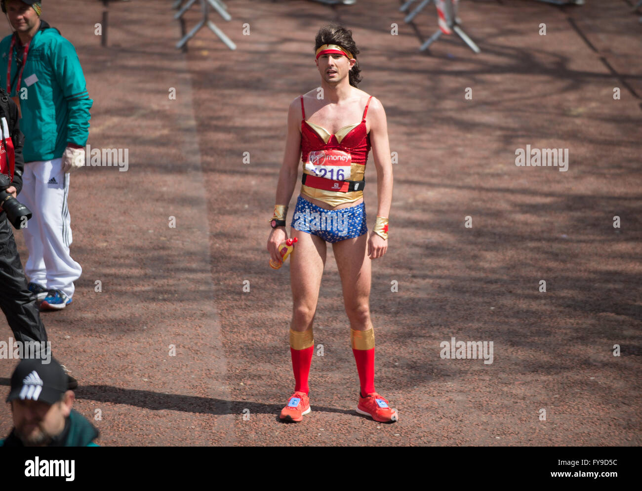 The Mall, London, UK. 24th April, 2016. 2016 Virgin London Marathon, Wonder Woman lookalike crosses the finish line. Credit:  sportsimages/Alamy Live News Stock Photo