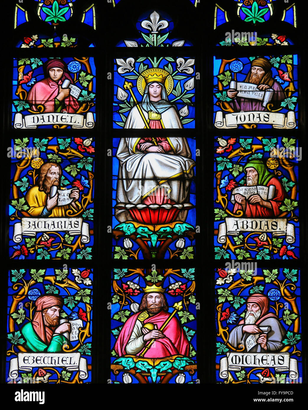 Stained Glass window in St. Vitus Cathedral, Prague, depicting Mother Mary and the Prophets Daniel, Jonah, Zachary, - Stock Image