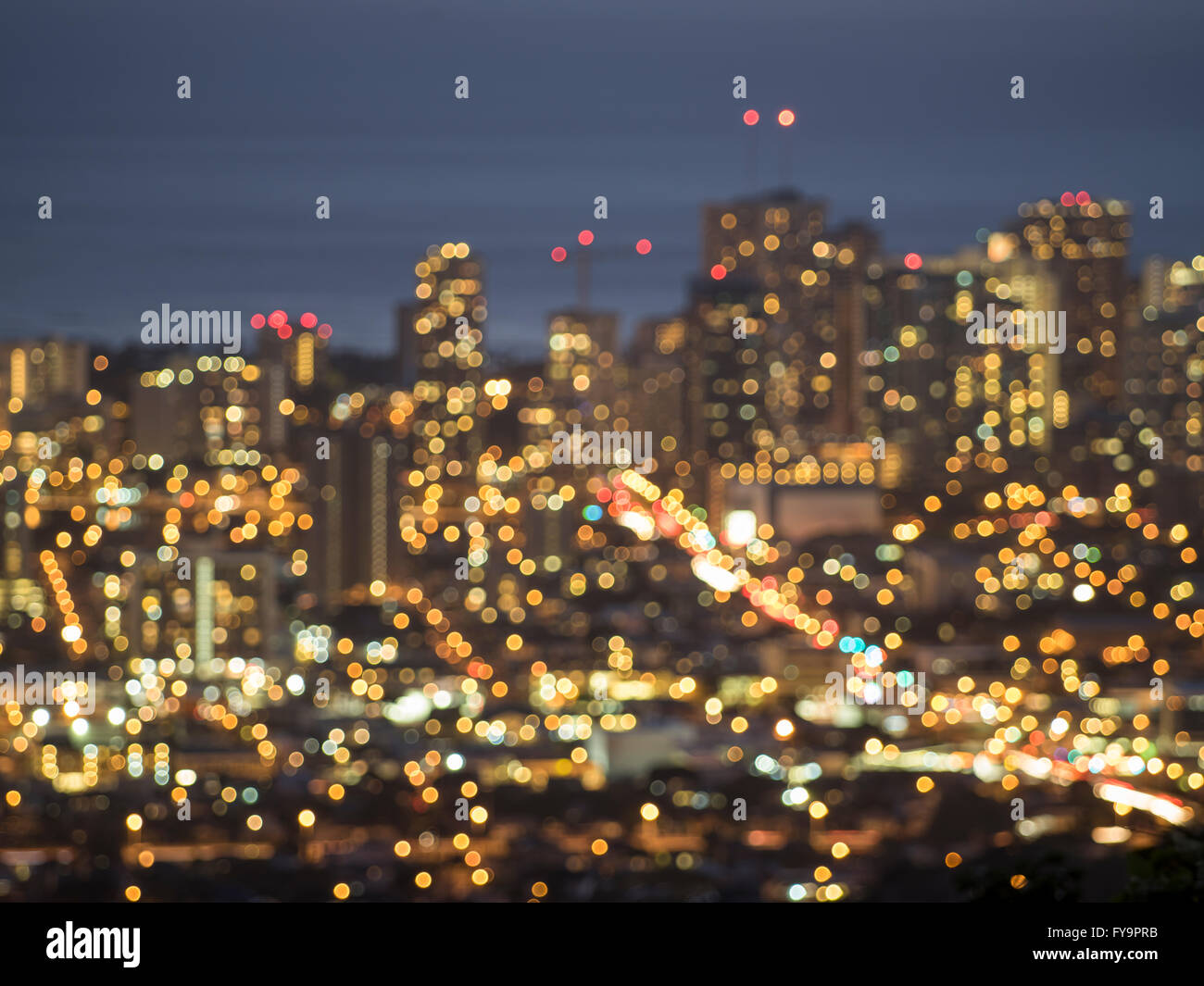 A bokeh view of Honoluu city lights at dusk from the Tantalus overlook. Stock Photo