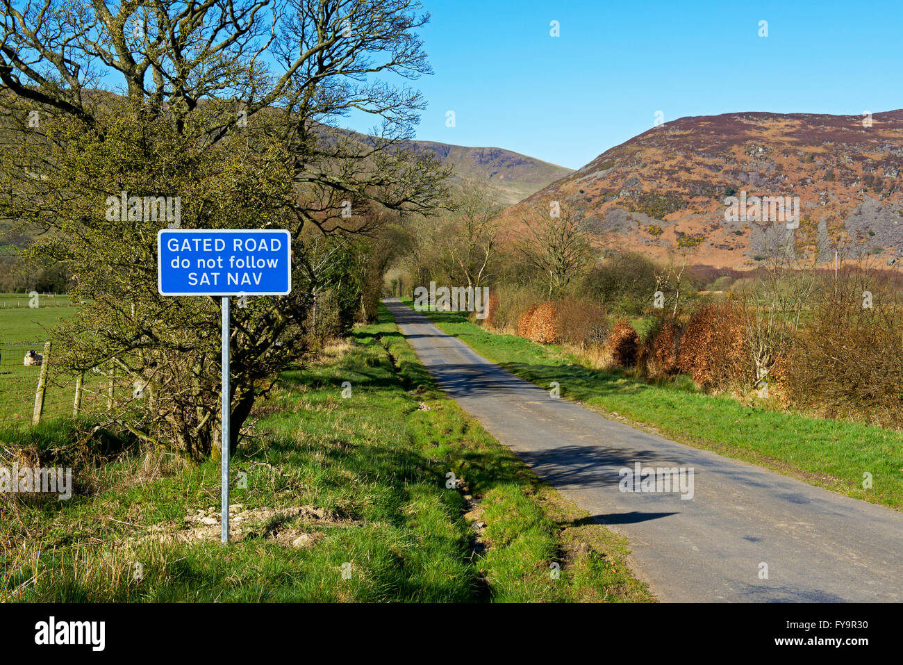 Sign: Gated road, do not follow satnav, Cumbria, England UK - Stock Image