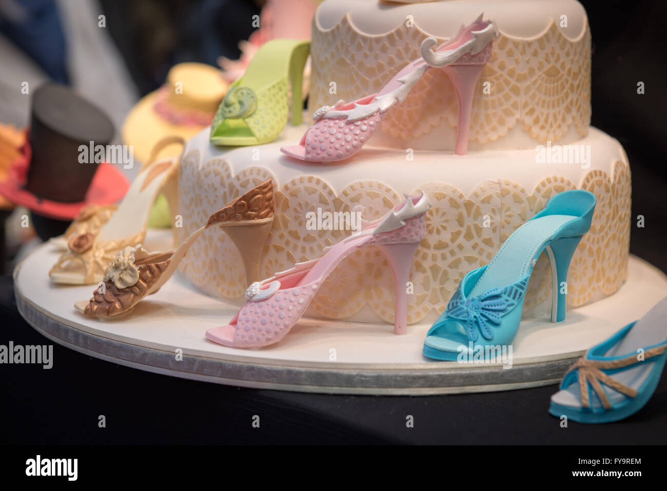 Edible high heels shoes birthday cake decor at Cake International