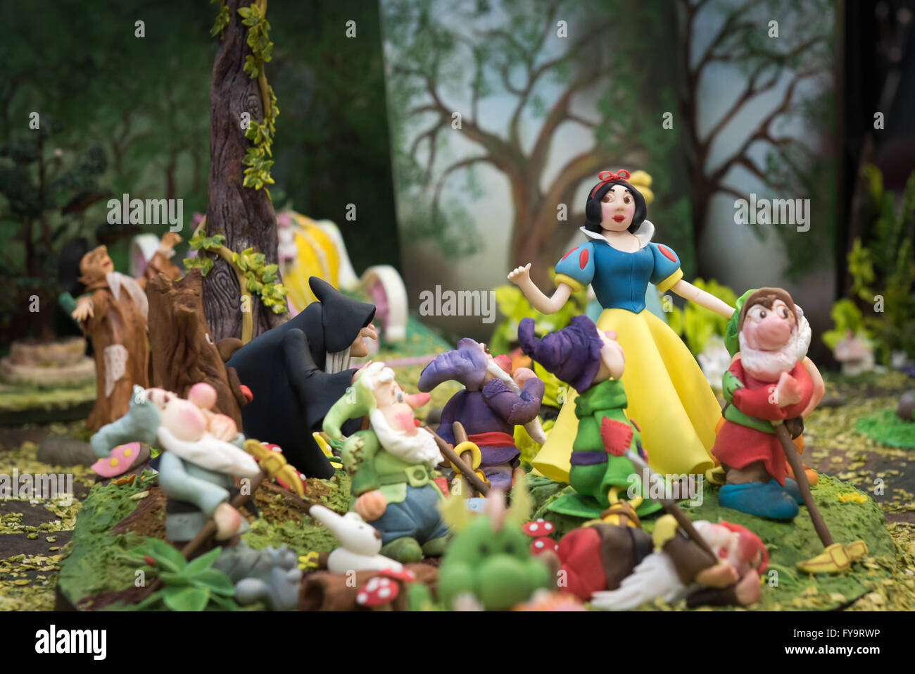 Snow White and the sever dwarfs and witch edible at Cake International – The Sugarcraft, Cake Decorating and Baking - Stock Image